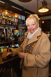 Author of 'One of the Family: 40 Years With The Krays' Maureen Flanagan, a former model and hairdresser to the Kray Twins' mother and friend for over 40 years of the brothers visits The Carpenters Arms on Cheshire Street in East London's Bethnal Green. The pub was once the scene of frivolous parties hosted by Reggie and Ronnie Kray, who dominated the capital's criminal underworld in the 50s and 60s. In 1967 they bought the pub for their mother, two years before they were given life sentences for their crimes. LONDON, January 10 2019.