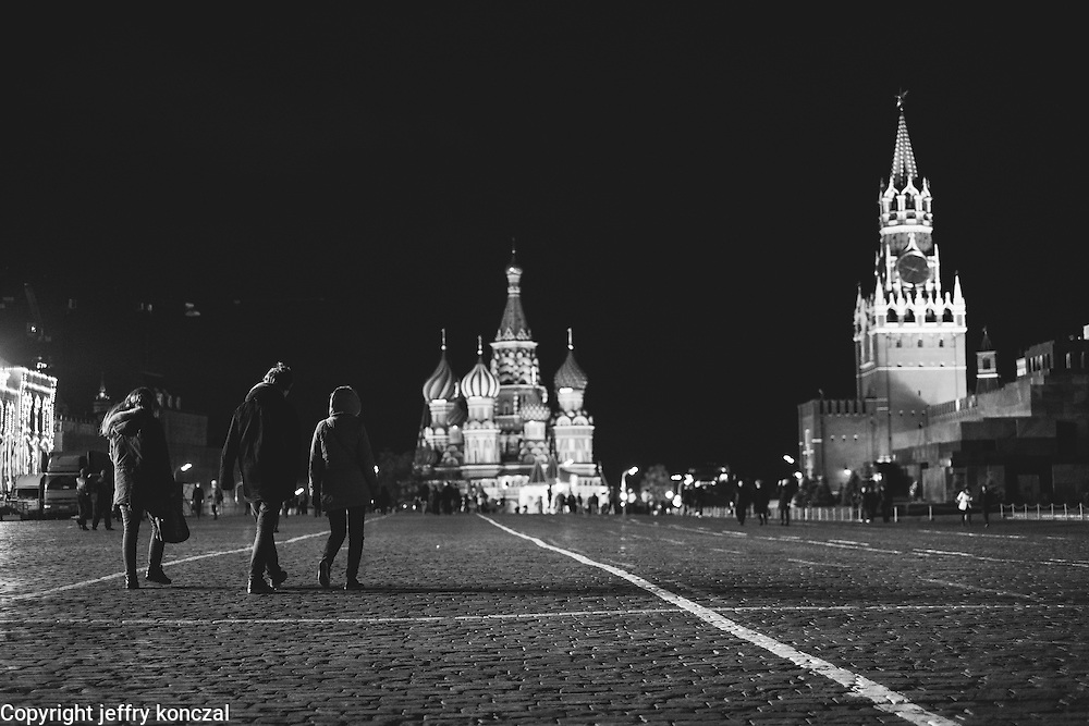People walk through Red Square with Saint Basil's Cathedral in the background in Moscow, Russia.