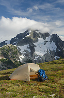 Backcountry camp on Red Face Mountain, Whatcom Peak seen in the distance. North Cascades National Park Washington