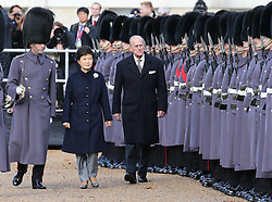 The Duke of Edinburgh  and the President of the Republic of Korea Her Excellency Park Geun-hye review a Guard of Honour during a Ceremonial Welcome for the President's  State Visit to the UK at  Horse Guards Parade in London , Tuesday, 5th November 2013. Picture by Stephen Lock / i-Images