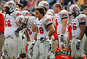 UNLV players from left; Nate Holloway, Mike Clausen, Calvin Randleman and Nate Carter react during the final seconds of their NCAA college football game against BYU at LaVell Edwards Stadium, Saturday, Nov. 6, 2010, in Provo, Utah. BYU defeated UNLV 55-7.  (AP Photo/Colin E. Braley)