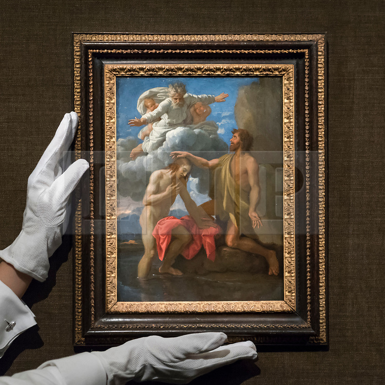 """© Licensed to London News Pictures. 29/11/2019. LONDON, UK. A technician presents """"The Baptist of Christ"""", 1648, by Nicolas Poussin (Est. GBP1.5-2.0m) at the preview of Old Masters sales at Sotheby's, New Bond Street.  Works will be offered for sale on 4 and 5 December.  Photo credit: Stephen Chung/LNP"""