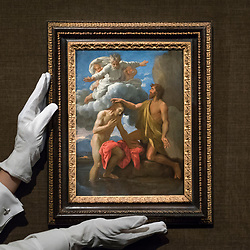"© Licensed to London News Pictures. 29/11/2019. LONDON, UK. A technician presents ""The Baptist of Christ"", 1648, by Nicolas Poussin (Est. GBP1.5-2.0m) at the preview of Old Masters sales at Sotheby's, New Bond Street.  Works will be offered for sale on 4 and 5 December.  Photo credit: Stephen Chung/LNP"