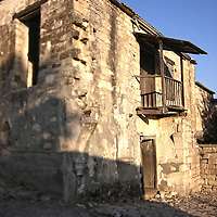 An old derelict building with wooden balcony in Cyprus
