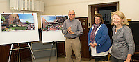 Campaign Executive Committee John Walker and Sandy Brallier with Pastor Paula Gile (center) showing renderings the construction project at the Congregational Church and Parish Hall in downtown Laconia.   (Karen Bobotas/for the Laconia Daily Sun)