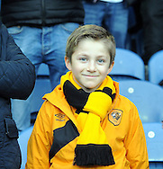 young fan of Hull City looking forward to the game during the Sky Bet Championship match at Elland Road, Leeds<br /> Picture by Graham Crowther/Focus Images Ltd +44 7763 140036<br /> 05/12/2015