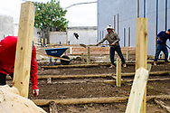 Pedro shovels dirt during construction of Frankford Pause, a community outdoor space created by the Frankford CDC.