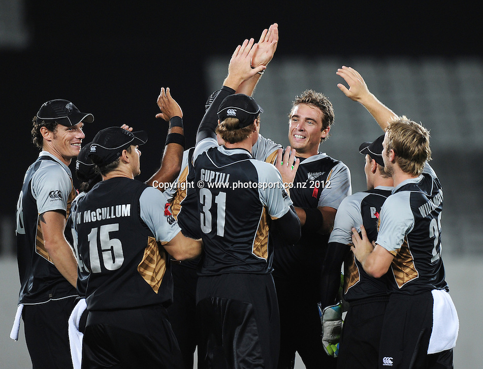 Tim Southee and Black Caps players celebrate the dismissal of Johan Botha during the 3rd and final InternationaI Twenty20 cricket match between New Zealand Black Caps and South Africa at Seddon Park, Hamilton, New Zealand on Wednesday 22 February 2012. Photo: Andrew Cornaga/Photosport.co.nz