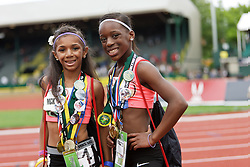 Olympic Trials Eugene 2012, sisters pose with medals and buttons after running Bantam 100 meter race