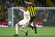 Manchester United Defender Chris Smalling battles with Watford forward Troy Deeney (9) during the Premier League match between Watford and Manchester United at Vicarage Road, Watford, England on 15 September 2018.