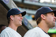 Justin Morneau #33 of the Minnesota Twins smiles from the dugout before a game against the Chicago White Sox on June 19, 2013 at Target Field in Minneapolis, Minnesota.  The Twins defeated the White Sox 7 to 4.  Photo: Ben Krause