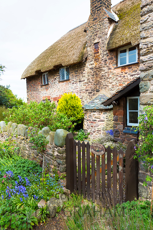 Quaint traditional cottage The Old Bakehouse with bread oven chimneyin Bossington in Exmoor, Somerset, UK