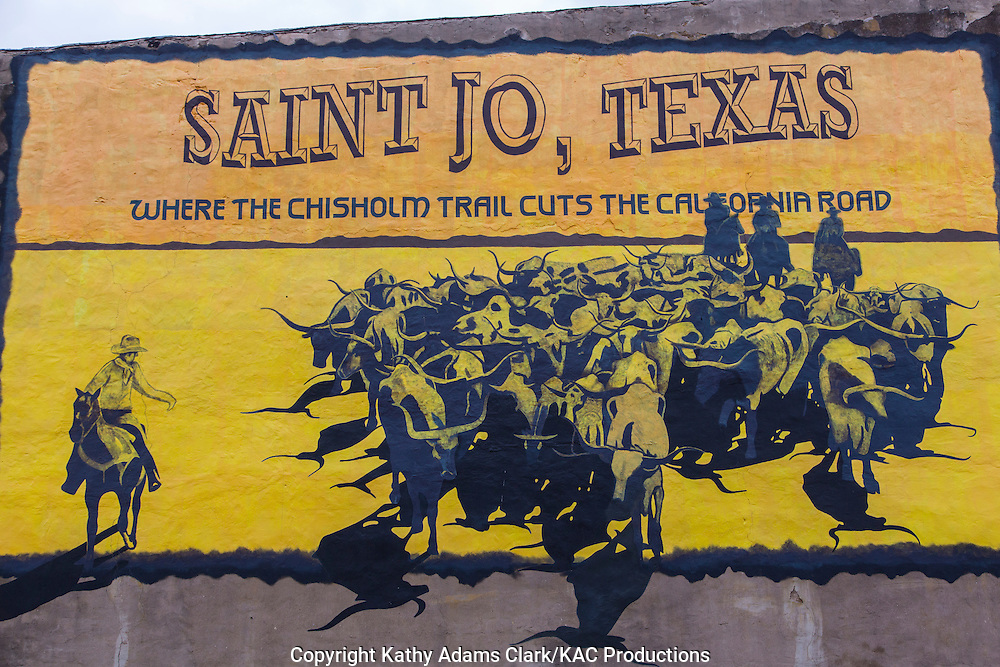 A mural in Saint Jo, Texas, commemorates the history Chisholm Trail cattle drives that passed through this area.