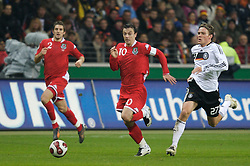 FRANKFURT, GERMANY - Wednesday, November 21, 2007: Wales' captain Simon Davies and Germany's Clemens Fritz during the final UEFA Euro 2008 Qualifying Group D match at the Commerzbank Arena. (Pic by David Rawcliffe/Propaganda)