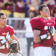 Stefan Russell, left, and Alex Highsmith observe the National Anthem before the start of the first game of the 28th Annual BB&T Football Jamboree Friday August 15, 2014 at Legion Stadium in Wilmington, N.C. (Jason A. Frizzelle)