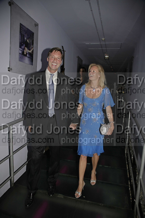Lord Brocket and Harriet Warren, Cartier Polo Players Party, The Collection, 264 Brompton Road, London, SW3, 25 July 2006. ONE TIME USE ONLY - DO NOT ARCHIVE  © Copyright Photograph by Dafydd Jones 66 Stockwell Park Rd. London SW9 0DA Tel 020 7733 0108 www.dafjones.com