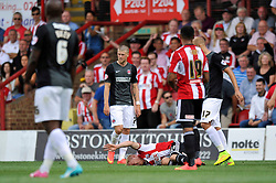 Brentford's Alex Pritchard rolls around after taking a knock - Photo mandatory by-line: Patrick Khachfe/JMP - Mobile: 07966 386802 09/08/2014 - SPORT - FOOTBALL - Brentford - Griffin Park - Brentford v Charlton Athletic - Sky Bet Championship - First game of the season