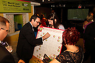 (from left at board) Aaron Hamer, Carrie Hawkins of Fairborn and Misty Sayre of Dayton during the 2013 Boonshoft Gala at the Boonshoft Museum of Discovery in Dayton.  The theme, Hip to be Square, is reflected in exhibits and demonstrations during the evening.
