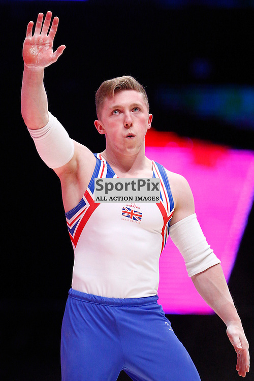 2015 Artistic Gymnastics World Championships being held in Glasgow from 23rd October to 1st November 2015....Great Britain's Nile Wilson performs in the Parallel Bars competition in the Men's Team Final...(c) STEPHEN LAWSON | SportPix.org.uk