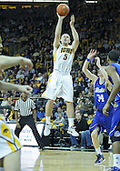 December 17, 2011: Iowa Hawkeyes guard Matt Gatens (5) puts up a shot during the the NCAA basketball game between the Drake Bulldogs and the Iowa Hawkeyes at Carver-Hawkeye Arena in Iowa City, Iowa on Saturday, December 17, 2011. Iowa defeated Drake 82-68.