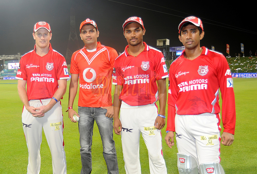 George Bailey captain of the Kings X1 Punjab (L to R), Vodafone Winner, Sandeep Sharma of the Kings X1 Punjab and Wriddhiman Saha of the Kings X1 Punjab during the presentation after match 15 of the Pepsi Indian Premier League 2014 Season between The Kings XI Punjab and the Kolkata Knight Riders held at the Sheikh Zayed Stadium, Abu Dhabi, United Arab Emirates on the 26th April 2014<br /> <br /> Photo by Pal Pillai / IPL / SPORTZPICS