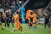 LAFC Goalkeeper Tyler Miller (1) secures a cross intended for Houston Dynamo defender Maynor Figueroa (15) during a MLS soccer game, Saturday, Sept 25, 2019, in Los Angeles. LAFC wins 3-1. (Jon Endow/Image of Sport)