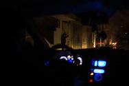 A men in the street on an east Gaza City district, the only lights are the cars head light. Un uomo in una strada di un quartiere a est di Gaza City, le uniche luci sono quelle delle macchine che passano