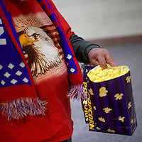 "A Vietnam veteran walks back to his set with popcorn before a ""Thank You Tour 2016"" rally for the President-elect Donald J. Trump December 15, 2016 at Giant Center in Hershey, Pennsylvania."