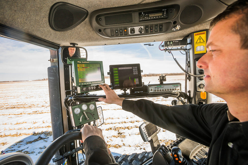 Farmer David Nelson looks over the computers and software in his tractor's cab that are part of the automated planting system, which he uses to plan and implement his corn and soybean  plantings on his farm near Fort Dodge, Iowa, on February, 18, 2014.