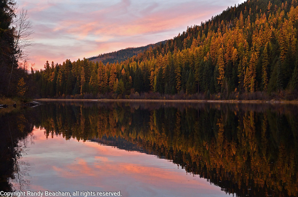 Hoskins Lake at sunset in fall. Yaak Valley, Montana.