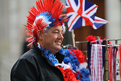 © Licensed to London News Pictures. 28/09/2016. Leeds, UK. A man sporting all union jack attire during the Olympic and Paralympic parade in Leeds. Yorkshire's Olympic and Paralympic stars receive a heroes' welcome during an open top bus parade in Leeds, West Yorkshire.  Photo credit : Ian Hinchliffe/LNP
