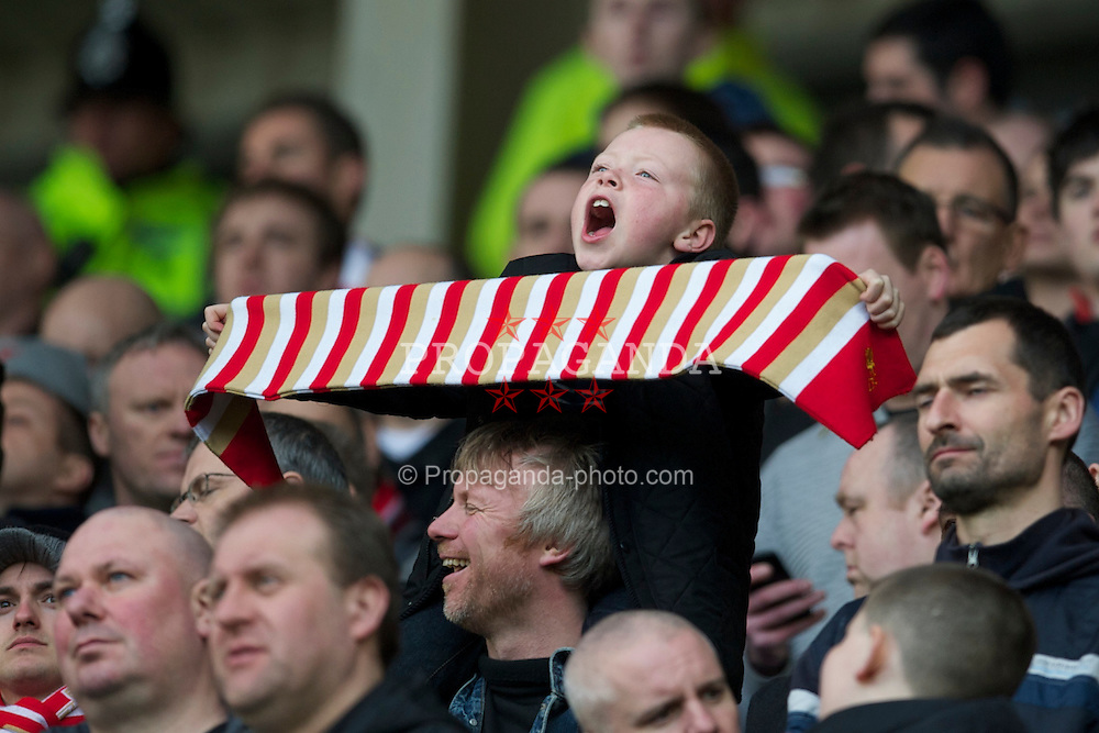 SUNDERLAND, ENGLAND - Sunday, March 20, 2011: A young Liverpool supporter celebrates his side's 2-0 victory over Sunderland during the Premiership match at the Stadium of Light. (Photo by David Rawcliffe/Propaganda)