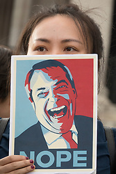 © Licensed to London News Pictures. 21/06/2016. London, UK. An activist holds a placard mocking UKIP leader Nigel Farage at a Remain campaign event in Trafalgar Square organised via Facebook. There are only two full days of campaigning ahead of the UK EU referendum taking place on Thirsday 23rd June, 2016. Photo credit: Peter Macdiarmid/LNP