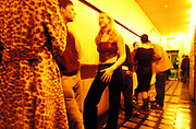 People standing in a corridor at a club, U.K, 1990s.