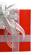 A boxed and wrapped present with an ornate silver bow to symbolize a gift.