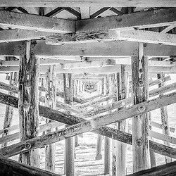 Newport Beach Pier black and white photo. Balboa Pier is located in Newport Beach in Orange County, Southern California. Image Copyright © 2012 Paul Velgos with All Rights Reserved.