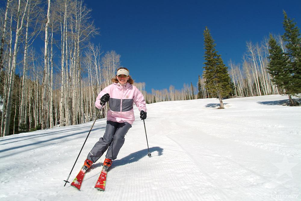 Jen skiing on groomed run at The Canyons, Park City, Utah, USA