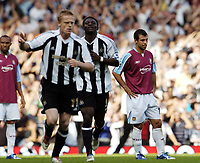 Photo: Olly Greenwood.<br />West Ham United v Newcastle United. The Barclays Premiership. 17/09/2006. West Ham's Javier Mascherano looks dejected as Newcastle's Damien Duff celebrates scoring