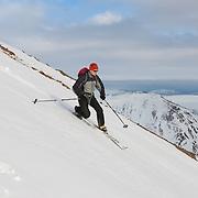 Afternoon skiing with Jón Haukur Steingrímsson to Móskarðshnjúkar. A mountain top on the east side of mt. Esja. Reykjavík, Iceland.