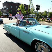 Tyler Christopher, an Elvis Tribute Artist, waves to Elvis fans as rides in the Elvis Homecoming Parade Thursday afternoon on Main Street in Tupelo.