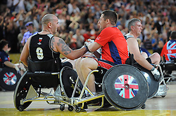 Grant Harvey of Great Britain shakes hands with New Zealand's Arron Soppet - Photo mandatory by-line: Dougie Allward/JMP - Mobile: 07966 386802 - 12/09/2014 - The Invictus Games - Day 2 - Wheelchair Rugby - London - Copper Box Arena