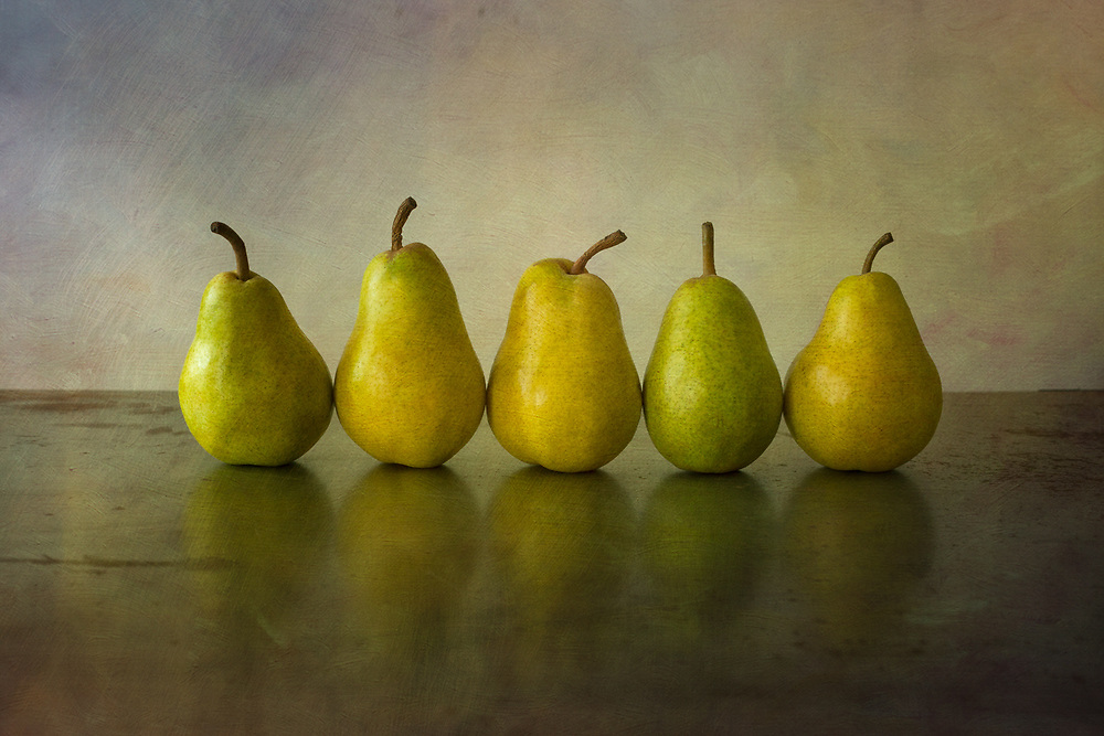 Five Pears in a Row on Rusted Metal styled and photographed in my studio. I loved the way the pears seemed to be dancing around.