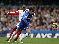 Photo: Lee Earle.<br /> Chelsea v Birmingham City. The Barclays Premiership.<br /> 31/12/2005.<br /> Chelsea's Paulo Ferreira (R) gets ahead of Emile Heskey.