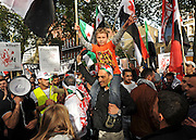 "35559258© Licensed to London News Pictures. 29/10/2011. London, UK.  A young boy sits on his father shoulders. Amnesty International join Syrians in the UK for a ""N0 More Blood - No More Fear"" march and rally in Paddington Green, London, today 29th October 2011. Activists claim  Syrian security forces opened fire on Friday on protesters and hunted them down in house-to-house raids, killing about 40 people in the deadliest day in weeks in the country's 7-month-old uprising. Photo: Stephen Simpson/LNP"