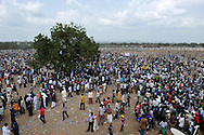 Thousands of people gather in front of the John Garang Memorial to celebrate South Sudan's independence. Just days before, Mines Advisory Group (MAG) in collaboration with SPLA demining teams cleared the highly contaminated area of unexploded ordinance to makie it safe for the historic event..Juba, South Sudan. 09/07/2011..Photo © J.B. Russell