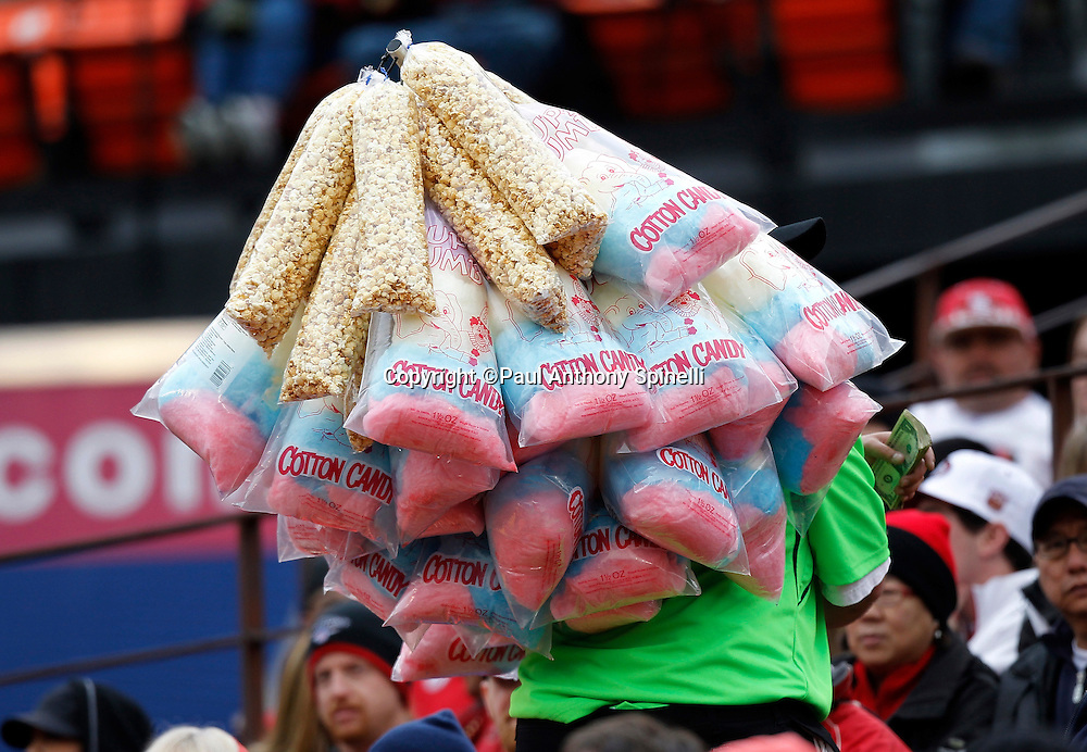 A cotton candy vendor hawks his wares during the San Francisco 49ers NFL week 17 football game against the Arizona Cardinals on Sunday, January 2, 2011 in San Francisco, California. The 49ers won the game 38-7. (©Paul Anthony Spinelli)