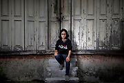 Ulairat Chooduang, a member of the Thai Volunteer Service sits in a small alleyway in Songkhla city. She is in the process of opening the first office of the Thai Volunteer Service located in Southern Thailand.
