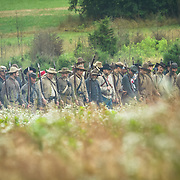 Confederate living historians line up for an artillery and skirmish demonstration, during the Sesquicentennial Anniversary of the Battle of Gettysburg, Pennsylvania on Wednesday, July 3, 2013.  The Battle of Gettysburg lasted from July 1-3, 1863 resulting in over 50,000 soldiers killed, wounded or missing.  John Boal Photography