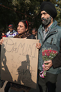 29th Dec. 2012. An Indian man and woman show their support at a vigil held in memory of a young medical student who was recently gang-raped in the India capital. Earlier that day news broke that the victim had died of her injuries.