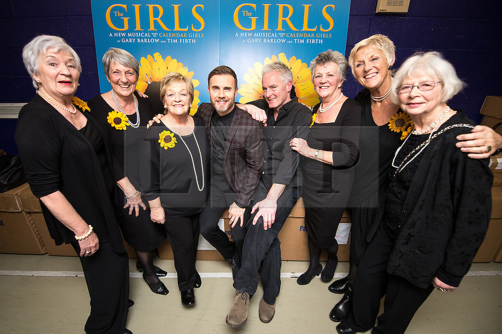 "© Licensed to London News Pictures . 12/01/2016 . Salford , UK . Writers GARY BARLOW and TIM FIRTH (pictured with the original Women's Institute members who made the calendar ) backstage after making a surprise appearance at the Lowry Theatre , during the opening week of "" The Girls "" , a musical they wrote based on the story "" Calendar Girls "" , about a group of Women's Institute members in Yorkshire , who made a nude calendar . Photo credit : Joel Goodman/LNP"